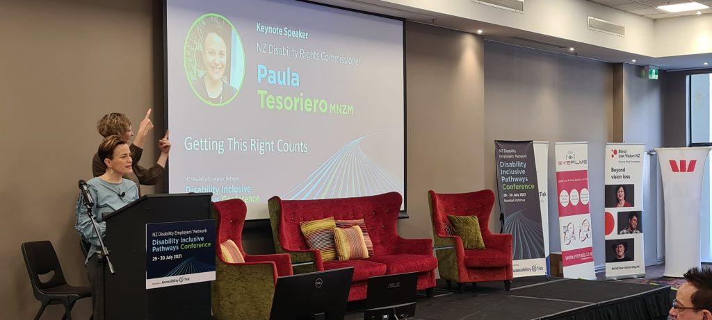 Keynote speaker Paula Tesoriero MNZM with NZSL interpreter behind her