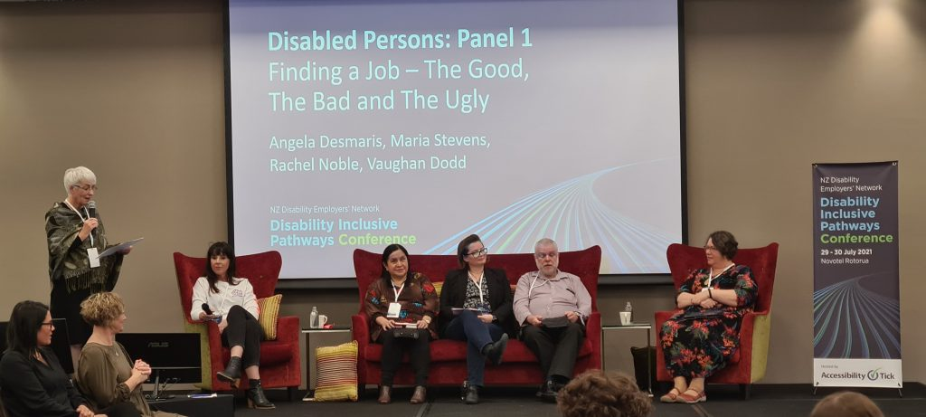 Disabled Persons Panel 1, Nataysha Tucker, Maria Stevens, Angela Desmaris, Vaughan Dodds and Rachel Noble. Panelists sit on a red sofa.