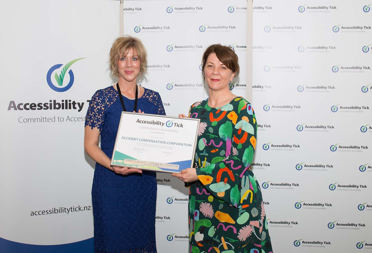 Tanya Colvin presenting the Accident Compensation Corporation certificate to Kellie Houlton