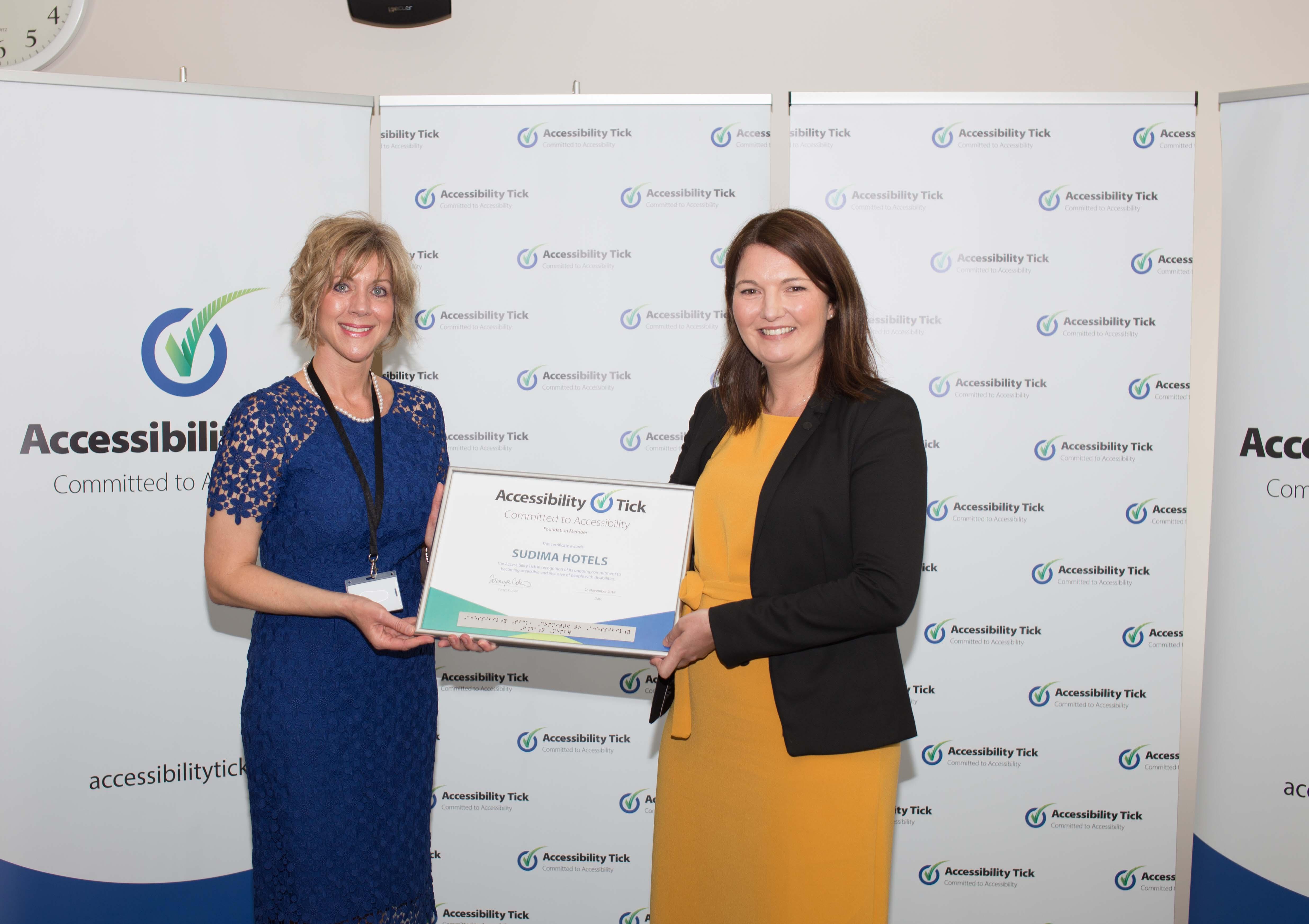 Tanya Colvin presenting the Sudima Hotels certificate to Phillipa Gimmillaro