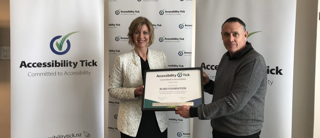 Tanya Colvin, Accessibility Tick Programme Lead and Acting Chief Executive Greg Hurn with the Accessibility Tick certificate