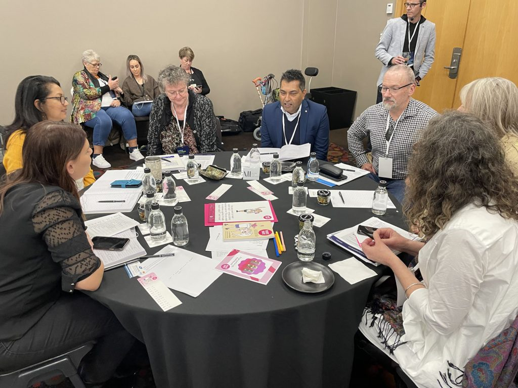 Table of conference delegates in discussion