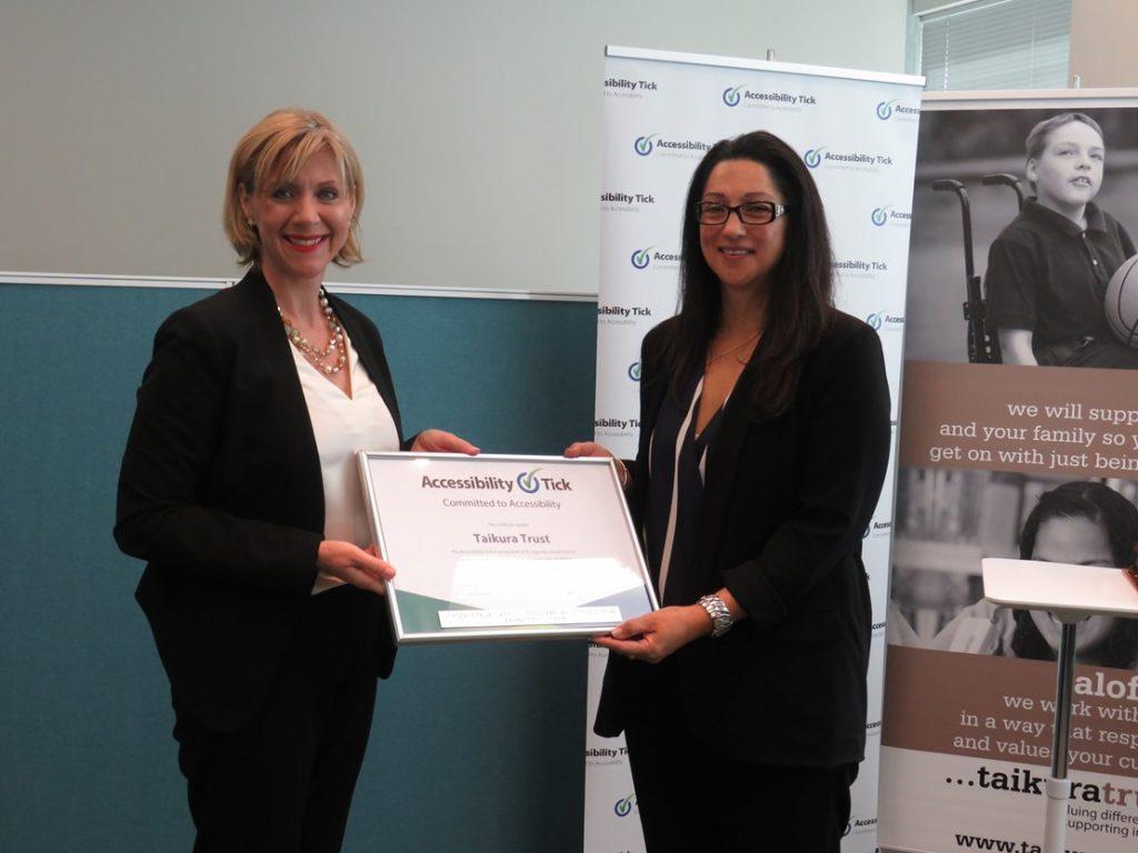 Sonia Hawea Taikura Trust CEO and Tanya Colvin Accessibility Tick Lead with Taikura Trust's Accessibility Tick certificate