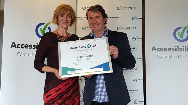 Tanya Colvin, Accessibility Tick programme lead, with Paul McCloskey, Vector hodling the Accessibility Tick certificate