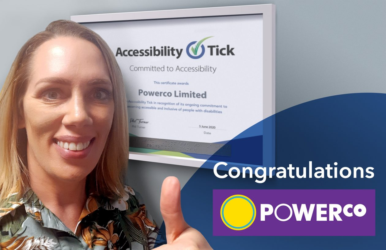 Powerco's Emma Bennett giving thumbs up next to their Accessibility Tick certificate with words Congratulations Powerco