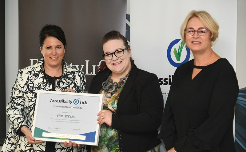 Fidelity Life CEO Nadine Terora, Accessibility Tick's Candace McCabe and Fidelity Life CPO Tanya Hadfield with the Accessibility Tick certificate.